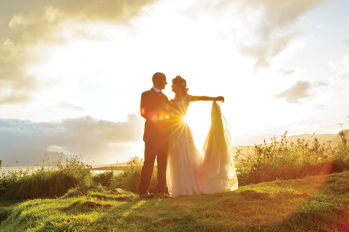 bride-and-groom-posing-at-sunset