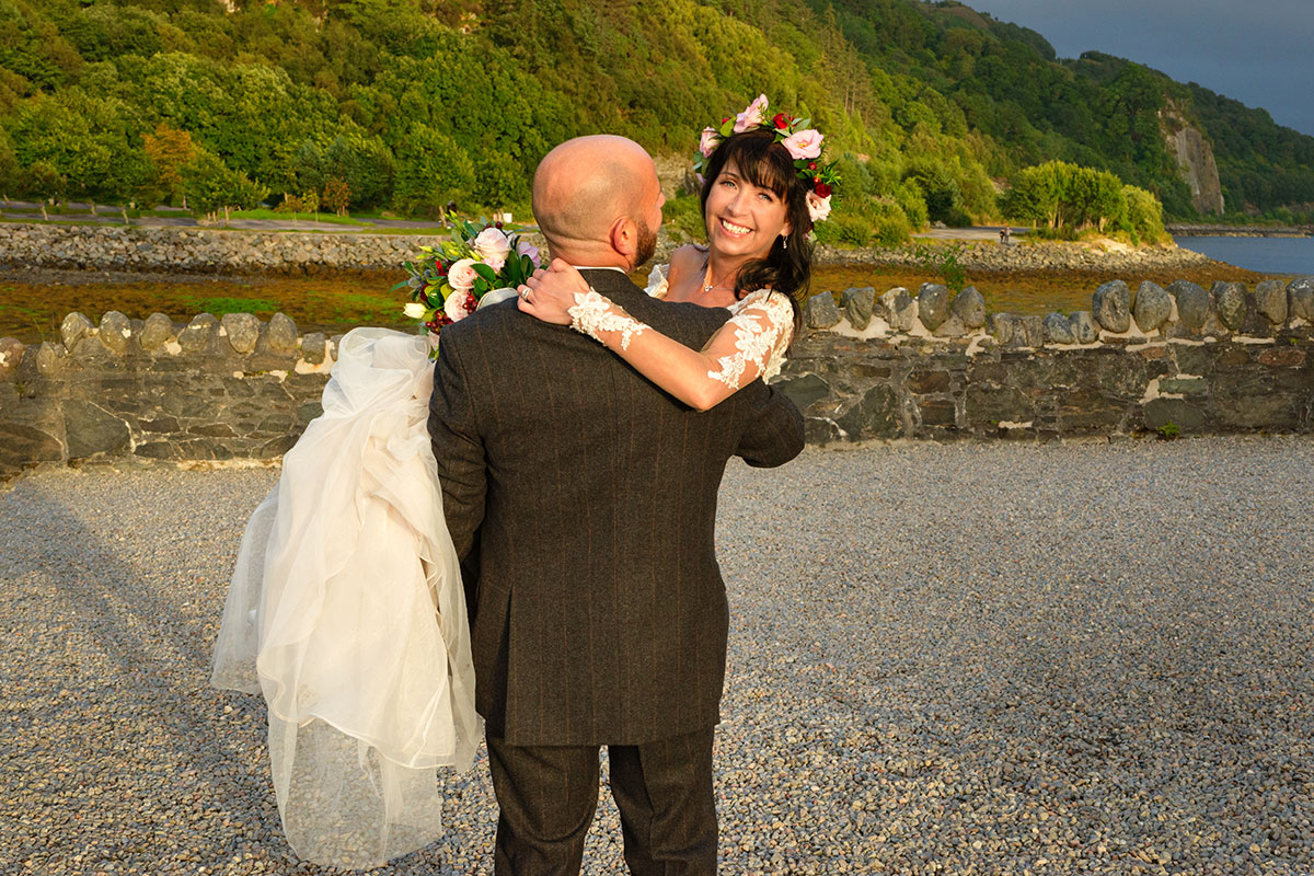 groom-carrying-bride-by-river