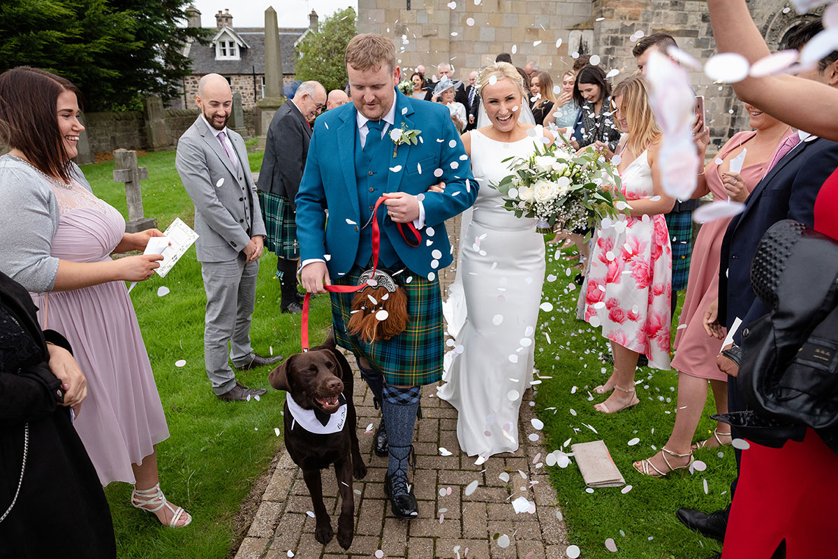 bride-and-groom-cofetti-shot-with-dog