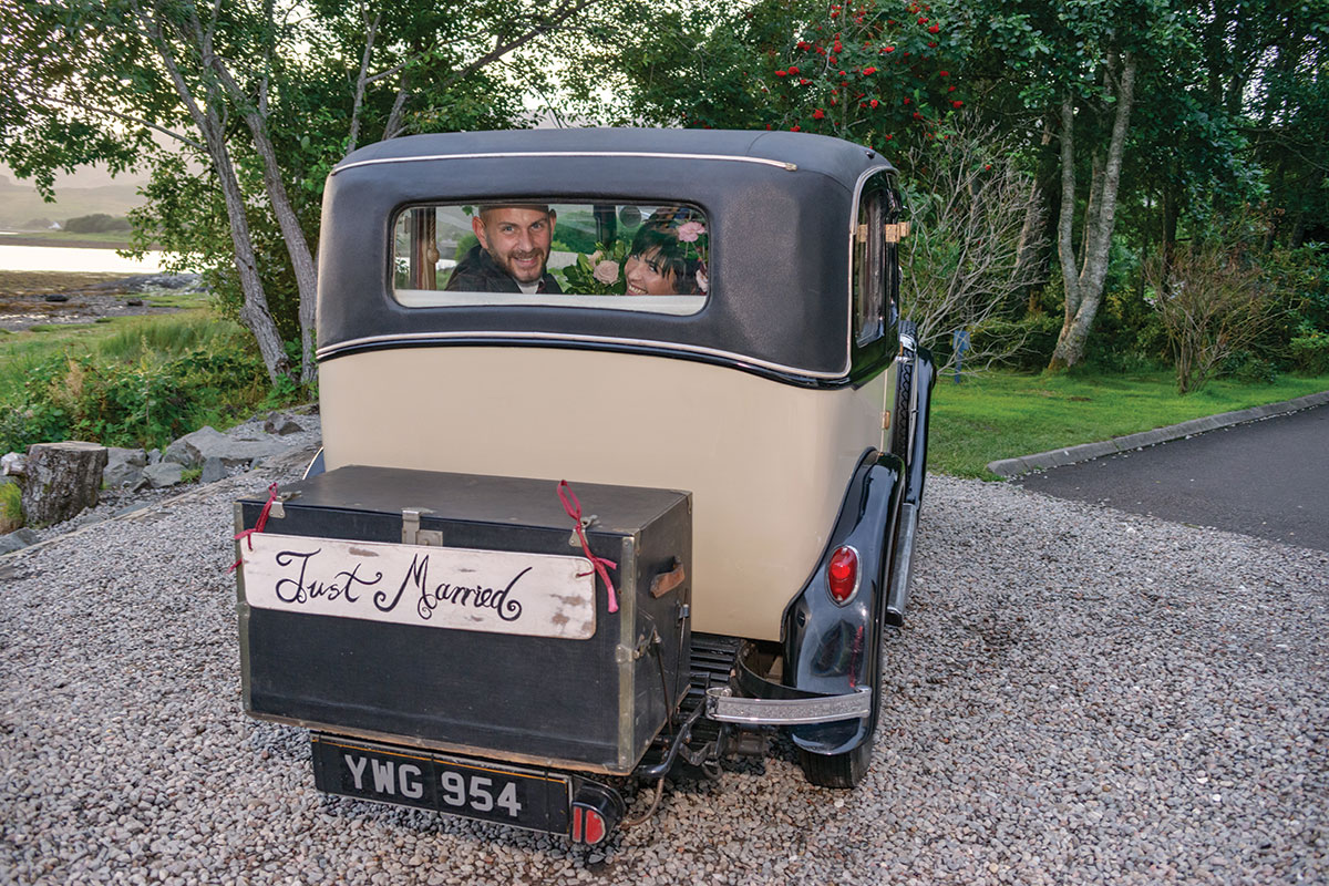 bride-and-groom-in-classic-wedding-car