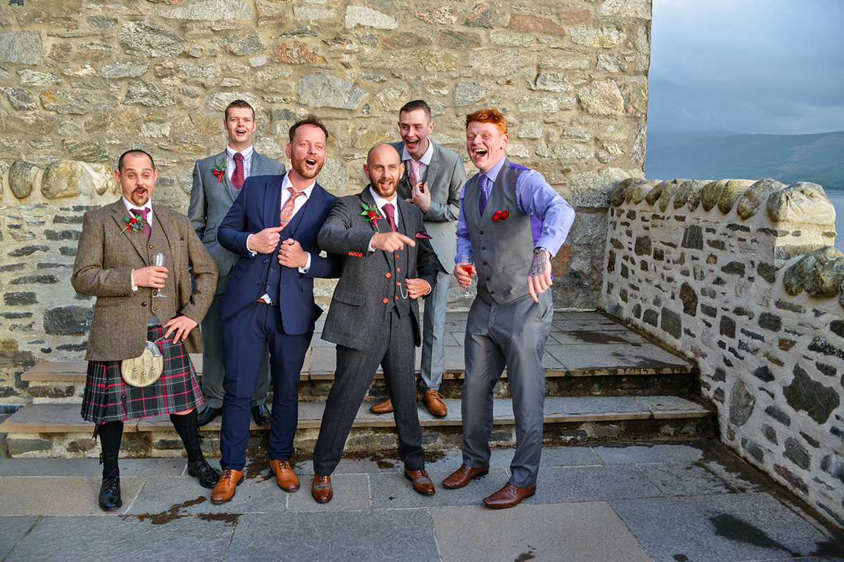 groom-and-groomsmen-in-a-selection-of-suits