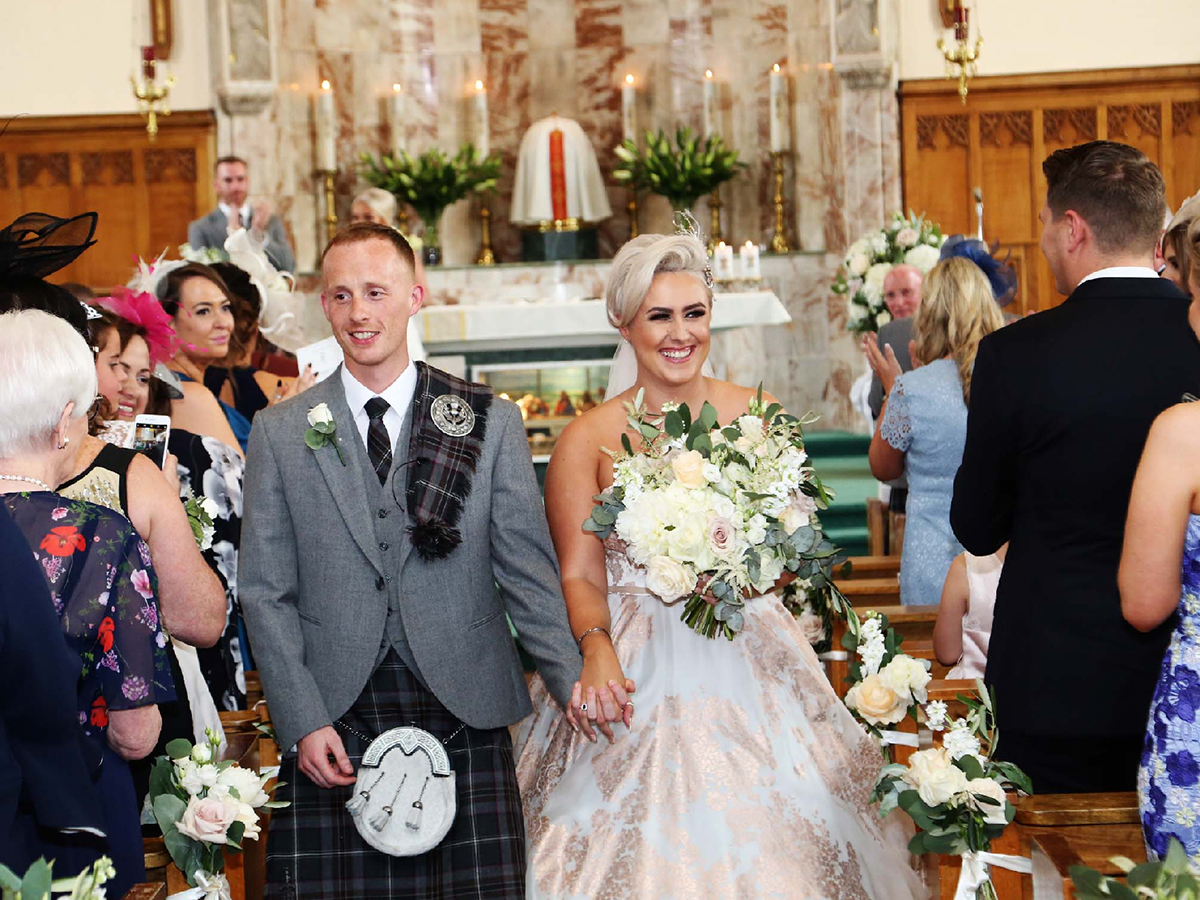 bride-and-groom-walking-down-the-aisle