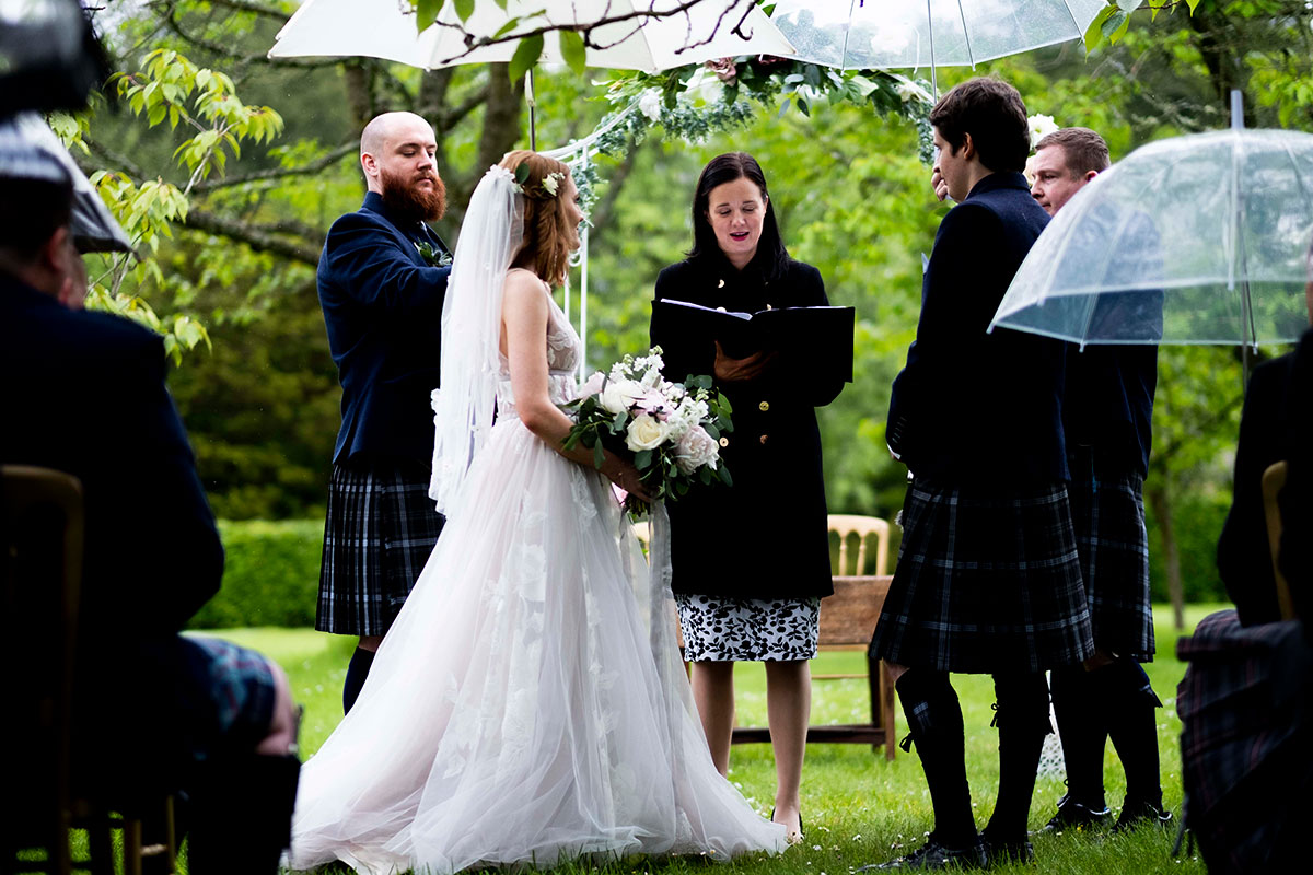 celebrant-speaking-during-outdoor-ceremony