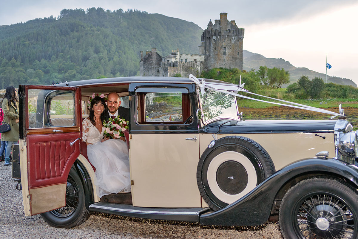 couple-in-classic-car-in-front-of-castle