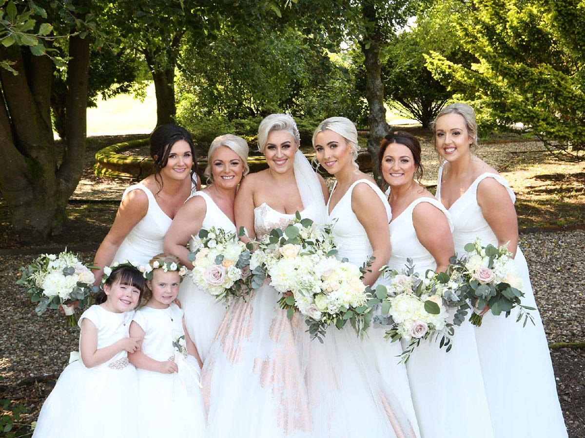 bride-and-bridesmaids-in-white-dresses