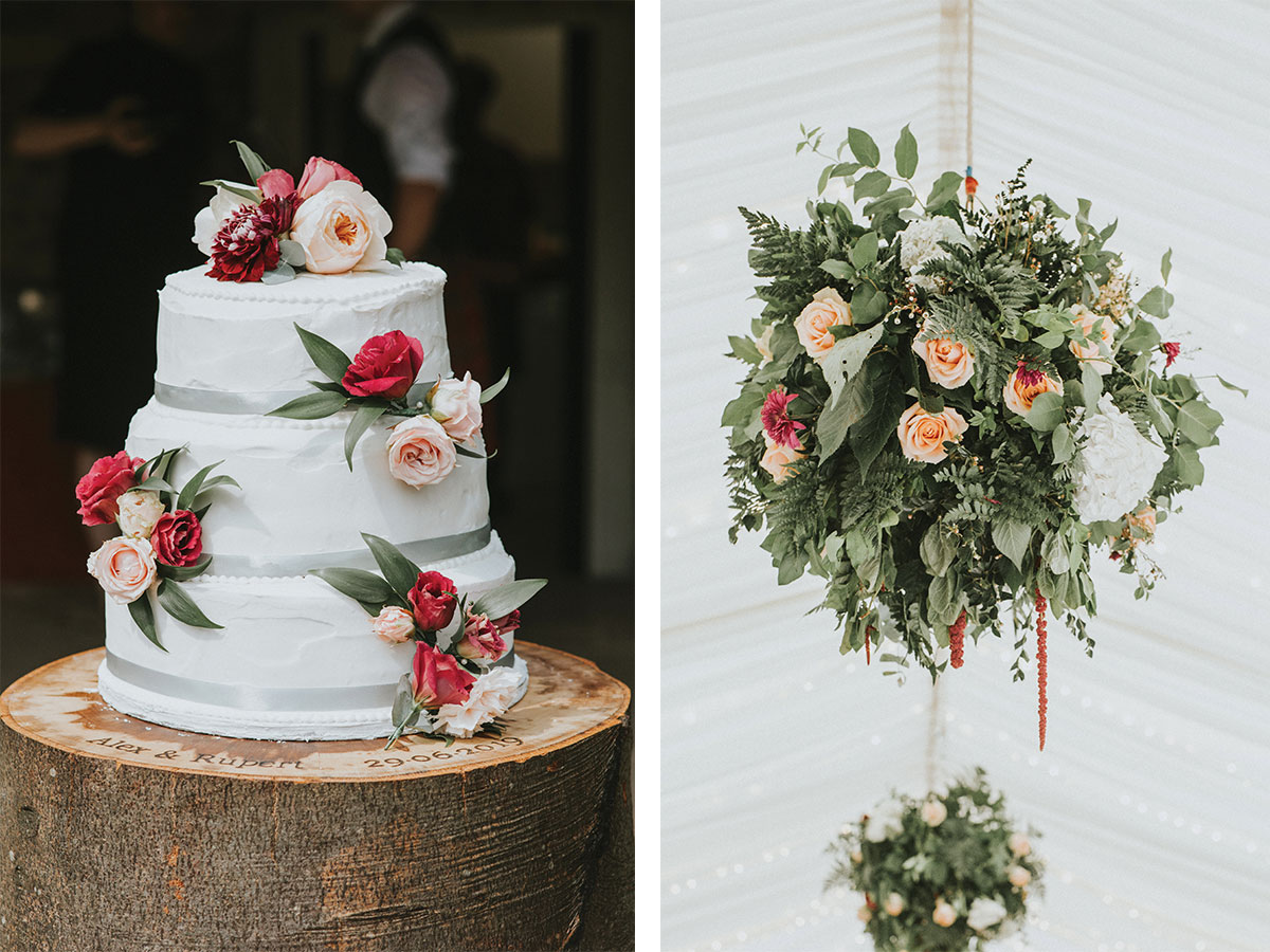 wedding-cake-and-floral-arrangement-hung-from-marquee-rafters