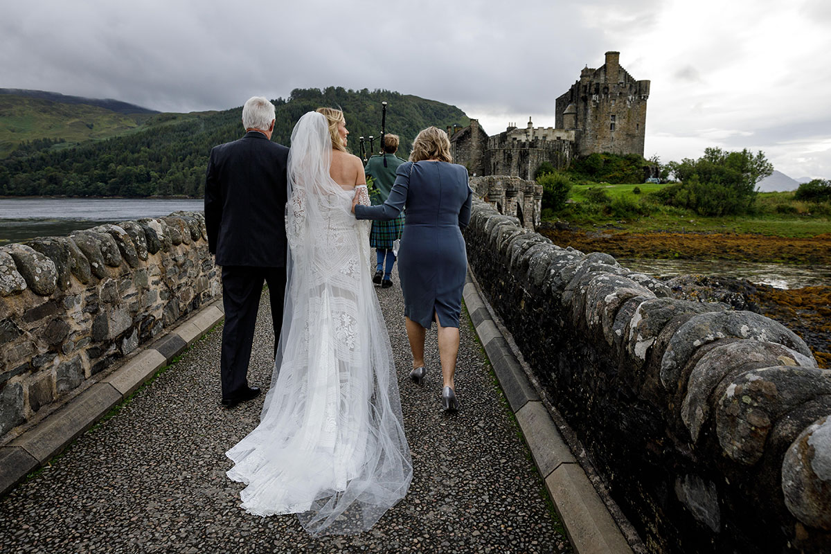 brides-parents-walking-her-up-the-path-to-the-castle