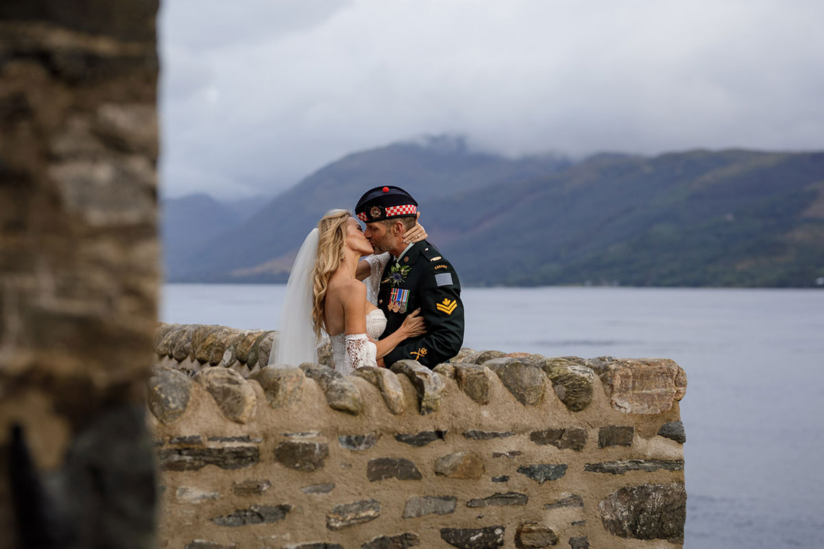 _bride-in-lace-dress-and-groom-wearing-kilt-outfit