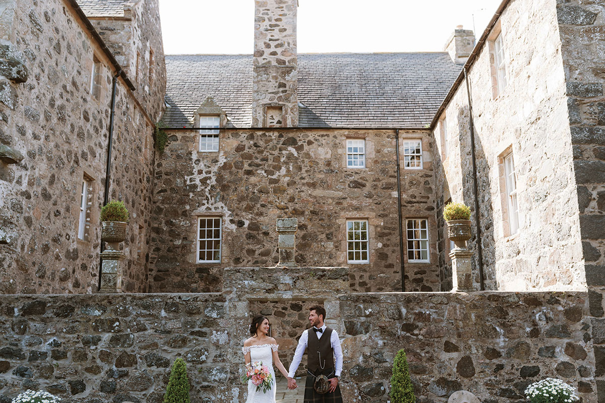 bride-and-groom-outside-barra-castle