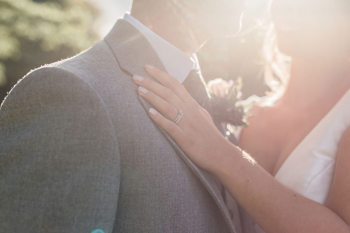 closeup-of-bride-and-grooms-hands