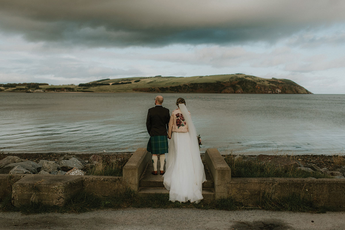 bride-and-groom-looking-out-to-the-water