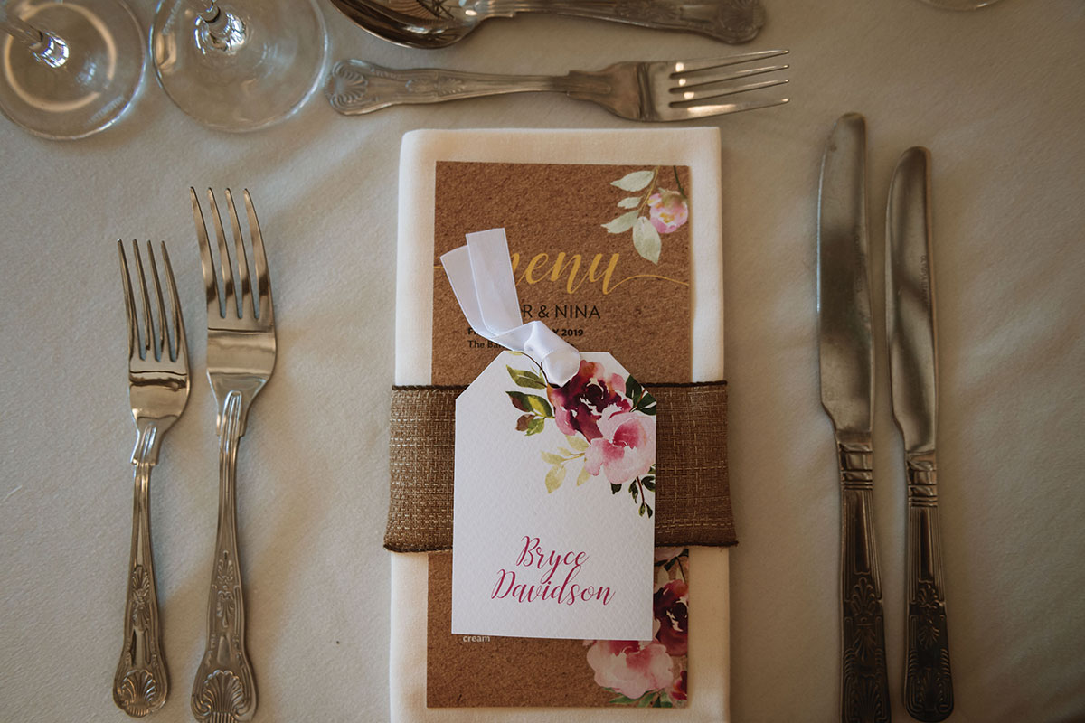 table-setting-with-calligraphy-tags