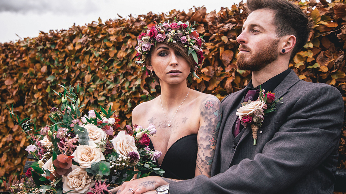 bride-with-tattoos-and-floral-crown-with-groom