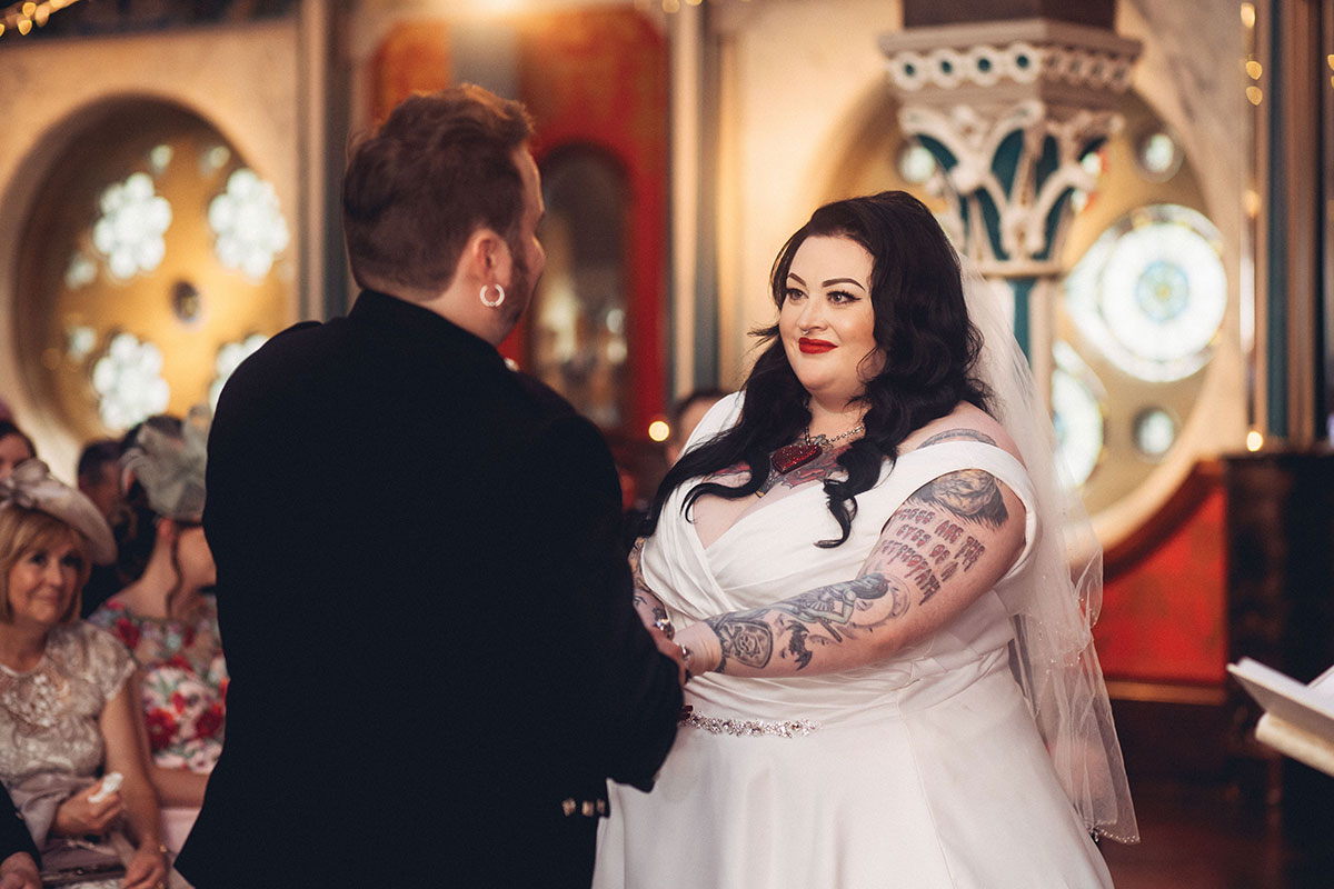 bride-looking-at-groom-during-ceremony