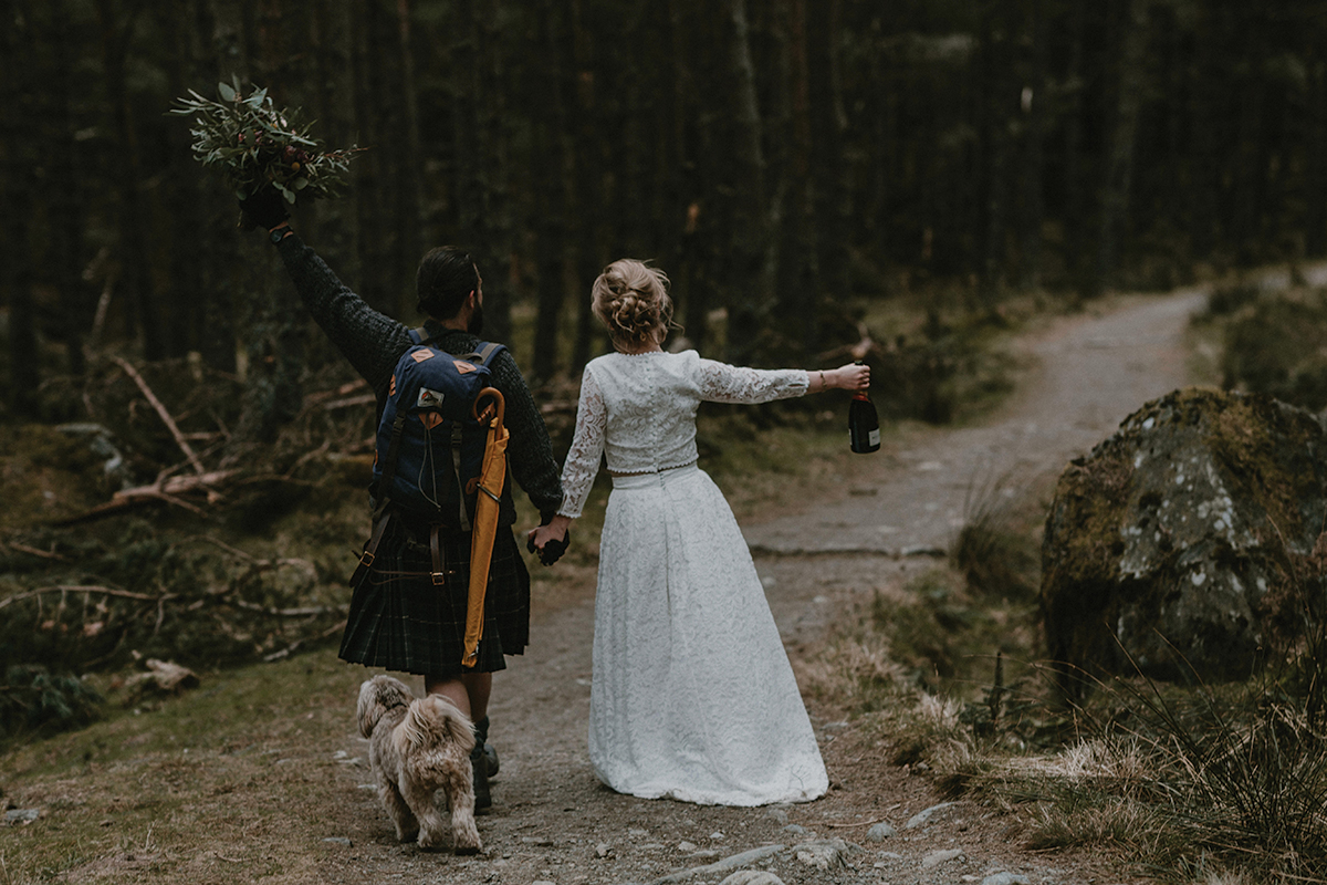 bride-and-groom-walking-their-dog-in-the-woods
