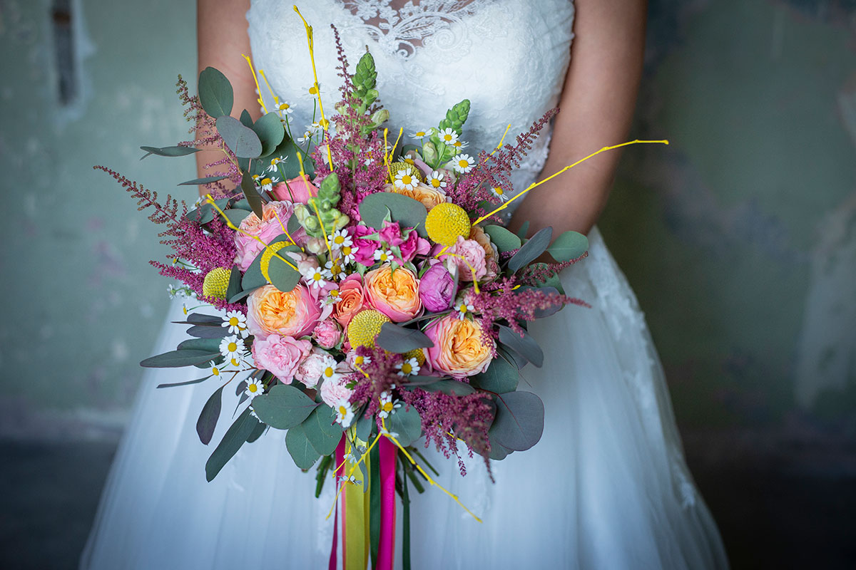 bridal-bouquet-with-pink-and-yellow-flowers-and-ribbons