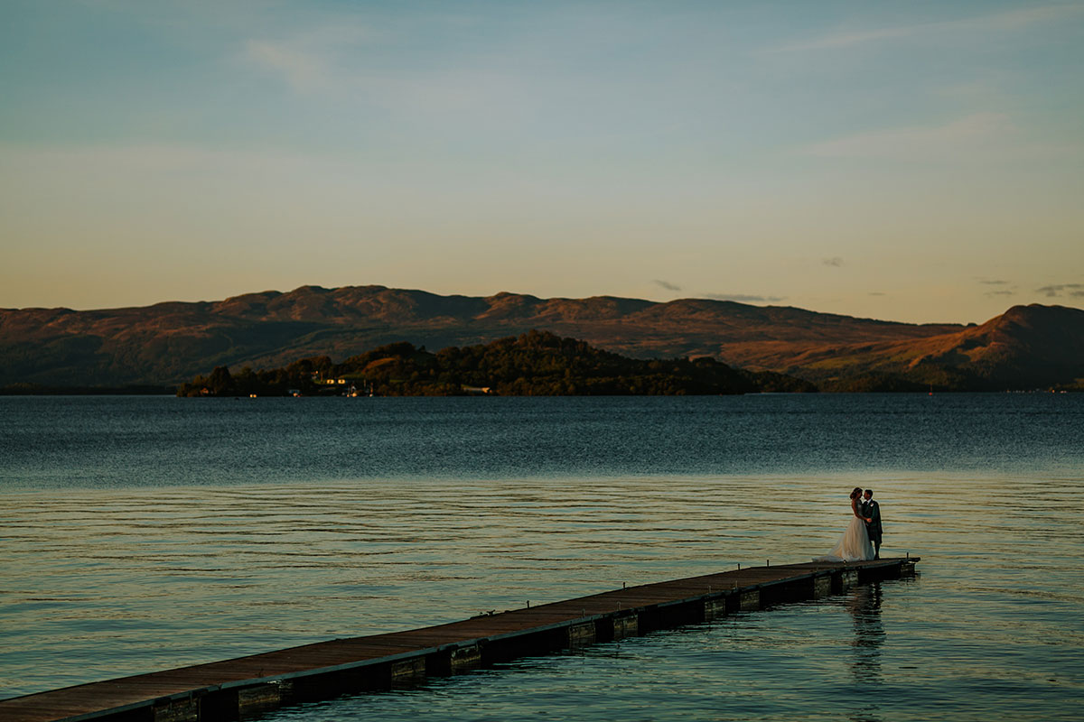bride-and-groom-at-the-end-of-the-bay-on-loch-lomond