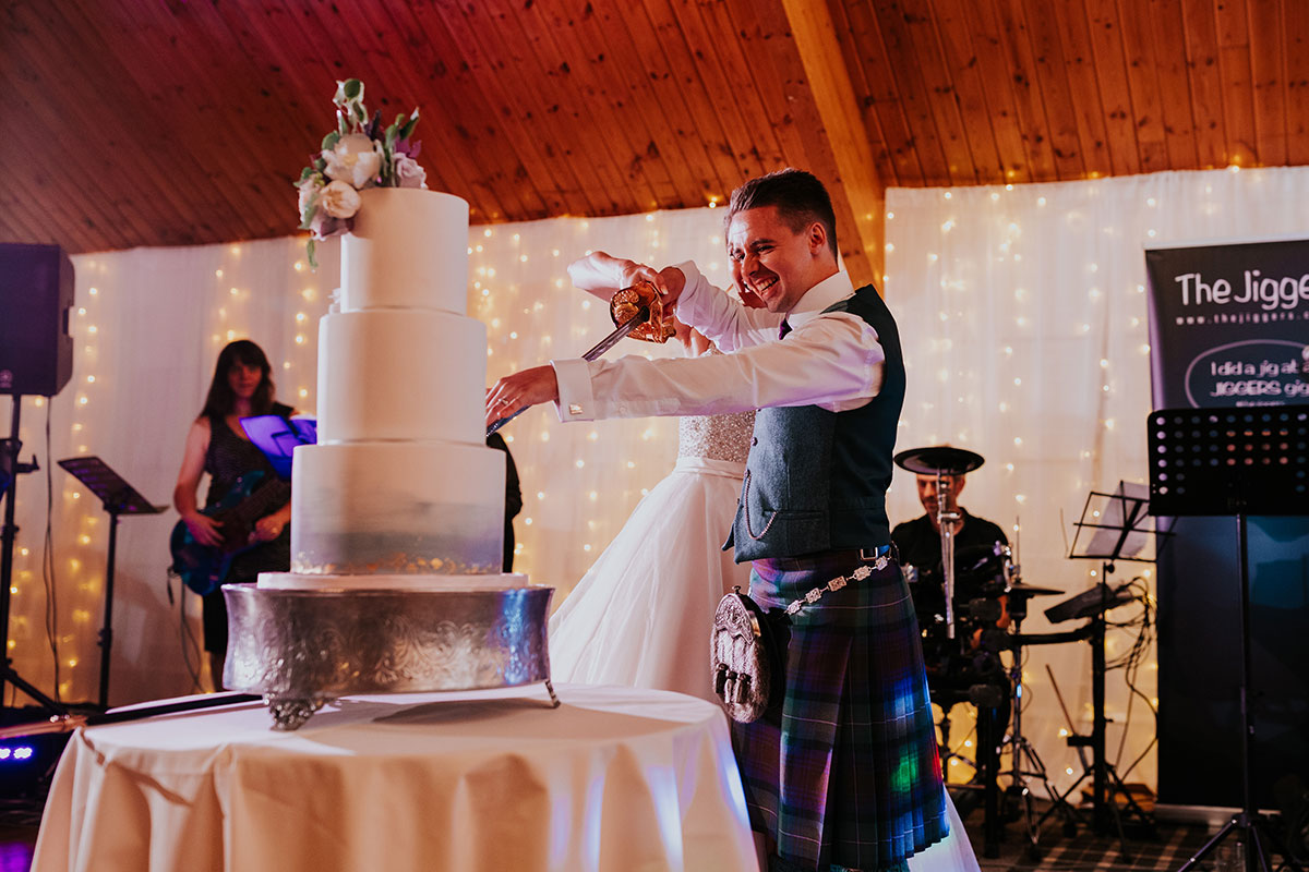 bride-and-groom-cutting-the-cake-with-a-sword