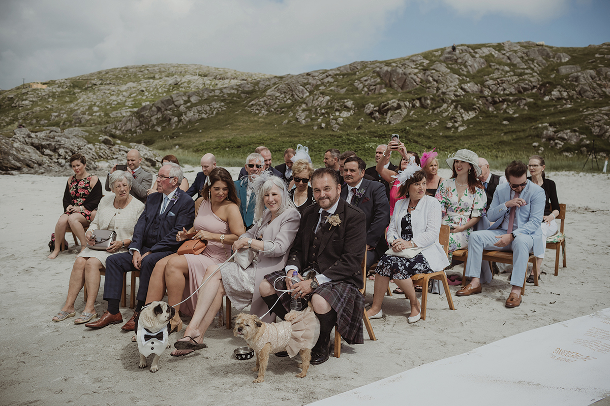 guests-sitting-on-the-beach-before-the-ceremony