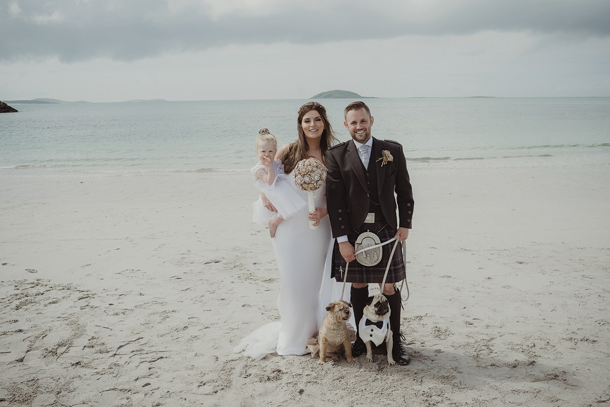 bride-and-groom-with-baby-and-dogs