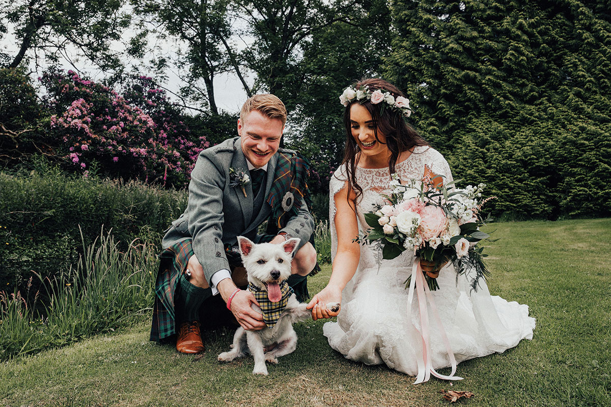 bride-and-groom-with-dog-in-tartan-jacket