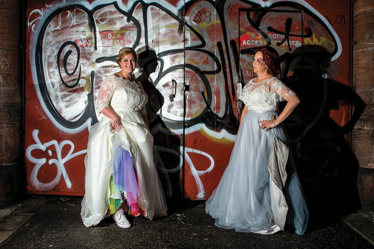 bride-with-rainbow-petticoat-in-front-of-grafitti