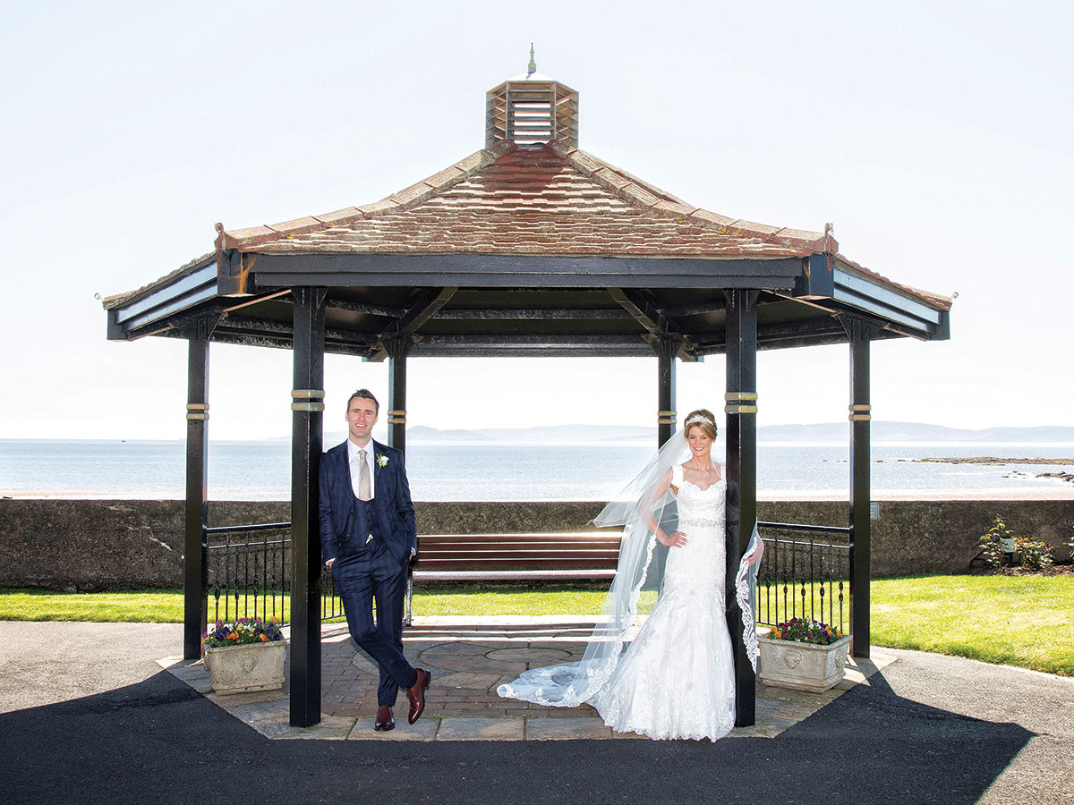 couple-standing-at-bandstand