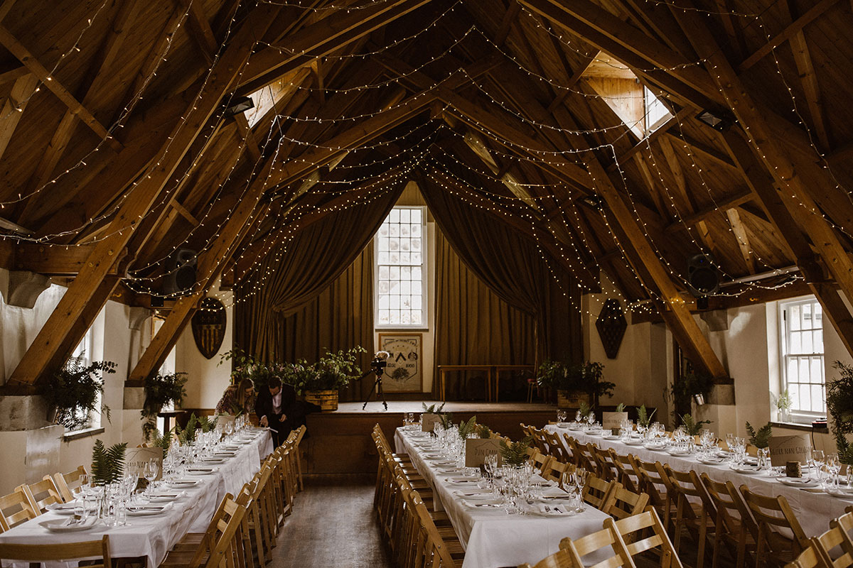 village-hall-dressed-for-wedding-breakfast-with-fairy-lights