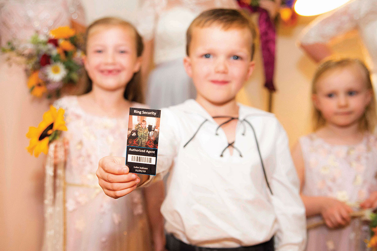 pageboy-holding-security-guard-card