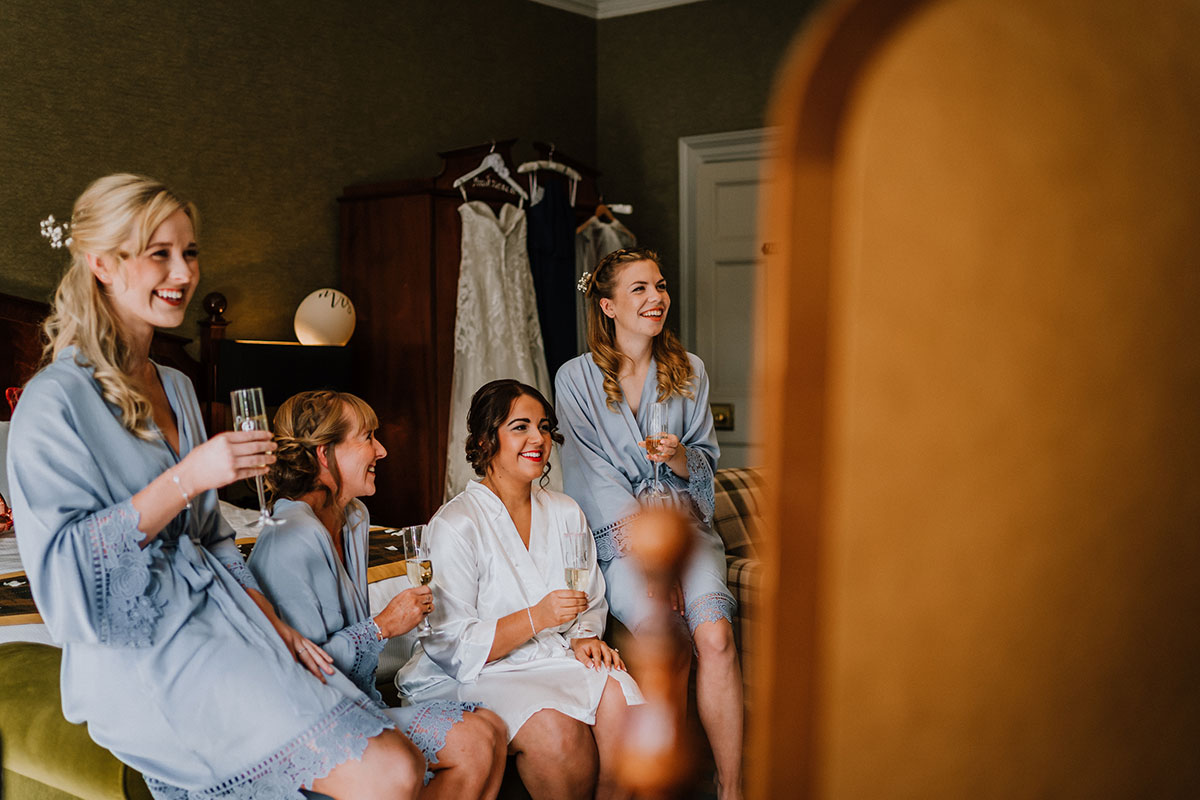 brides-and-bridesmaids-enjoying-champagne-in-matching-robes