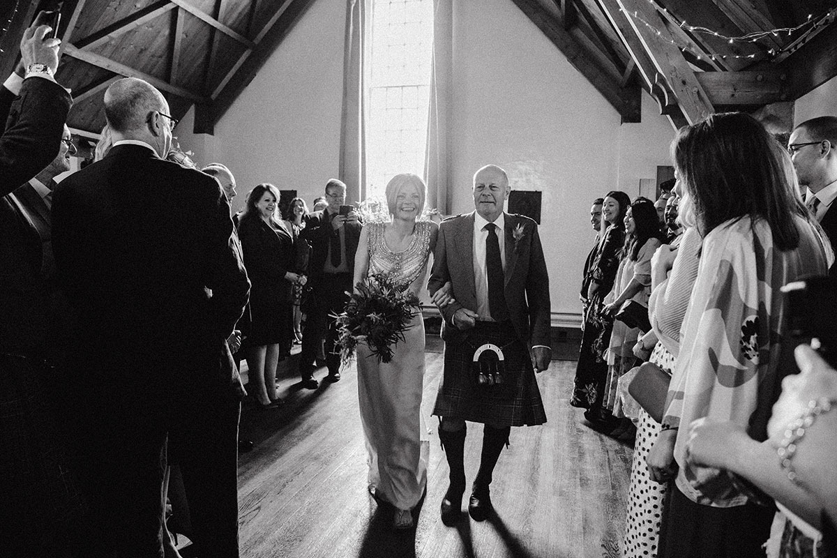 father-of-the-bride-walking-bride-down-aisle
