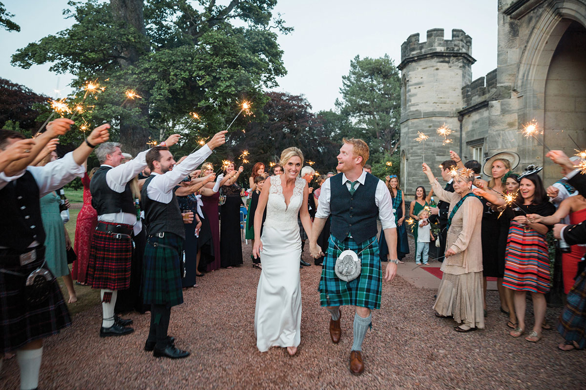 couple-outside-winton-house-guests-with-sparklers