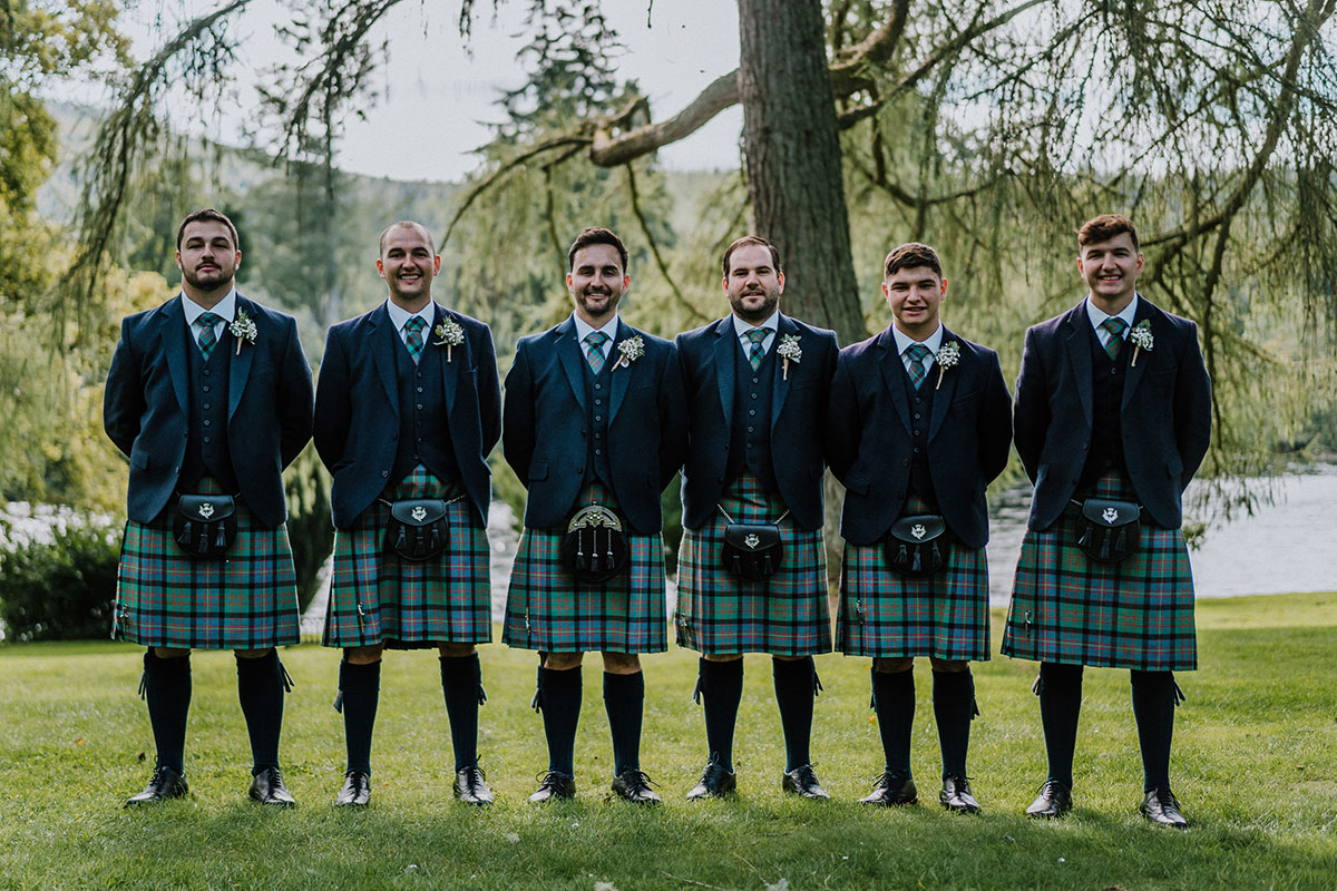 grooms-in-navy-kilt-outfits-with-green-tartan