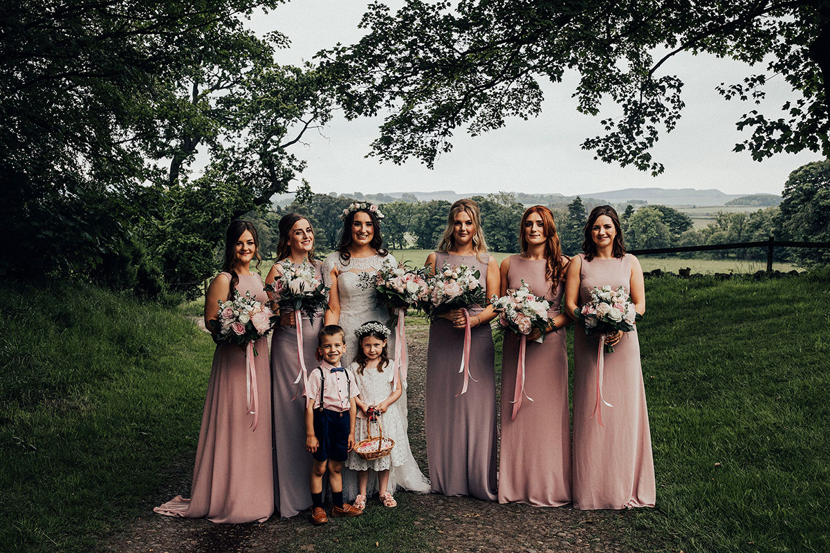 bride-in-cape-and-bridesmaid-in-light-purple-and-dusky-pink-dresses