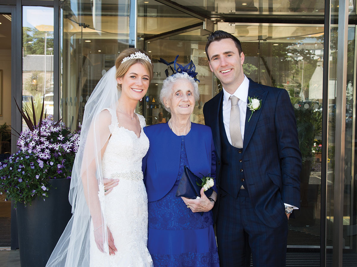 couple-with-grandmother-outside-venue