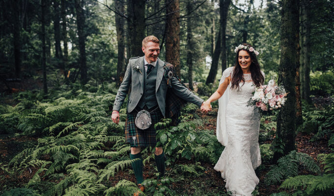 -bride-and-groom-in-forest-full-of-ferns