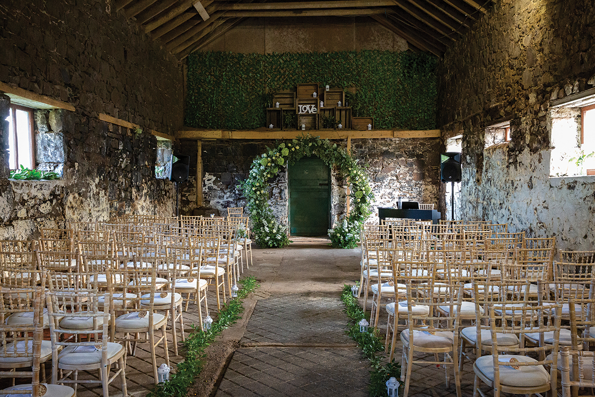 wildrose-flowers-barn-dressed-for-wedding-ceremony
