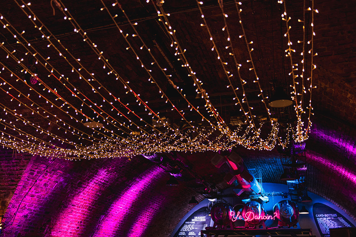the-ceiling-at-argyle-street-arches-with-fairy-lights-and-neon-light