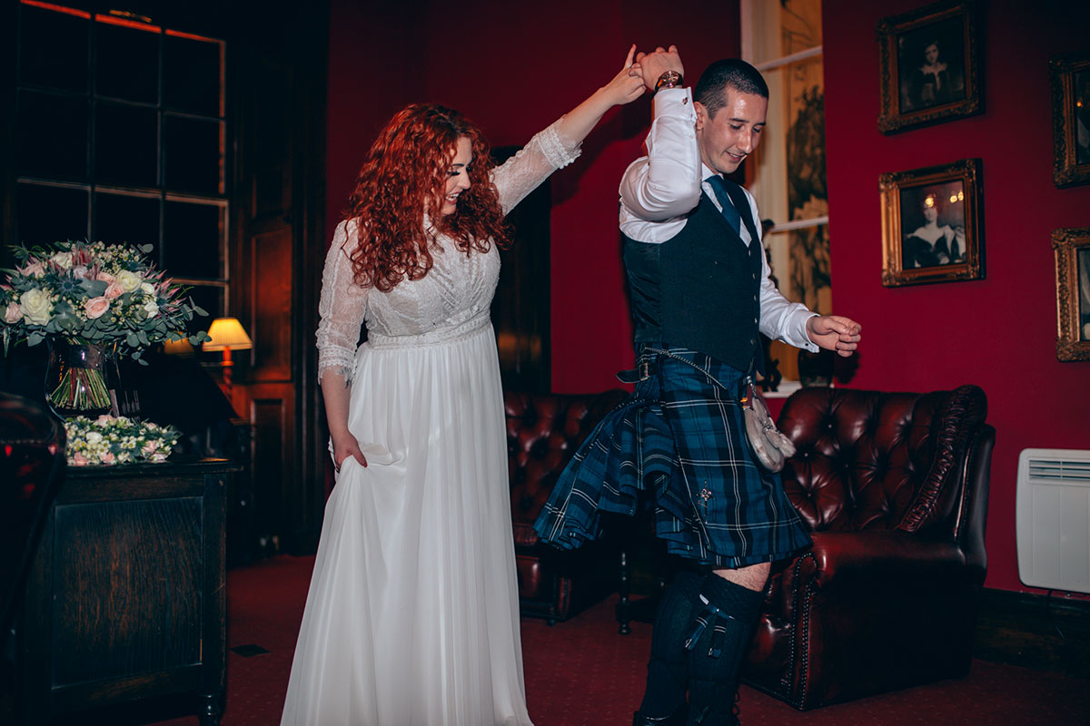 couple-having-first-dance-in-dalhousie-castle-lounge