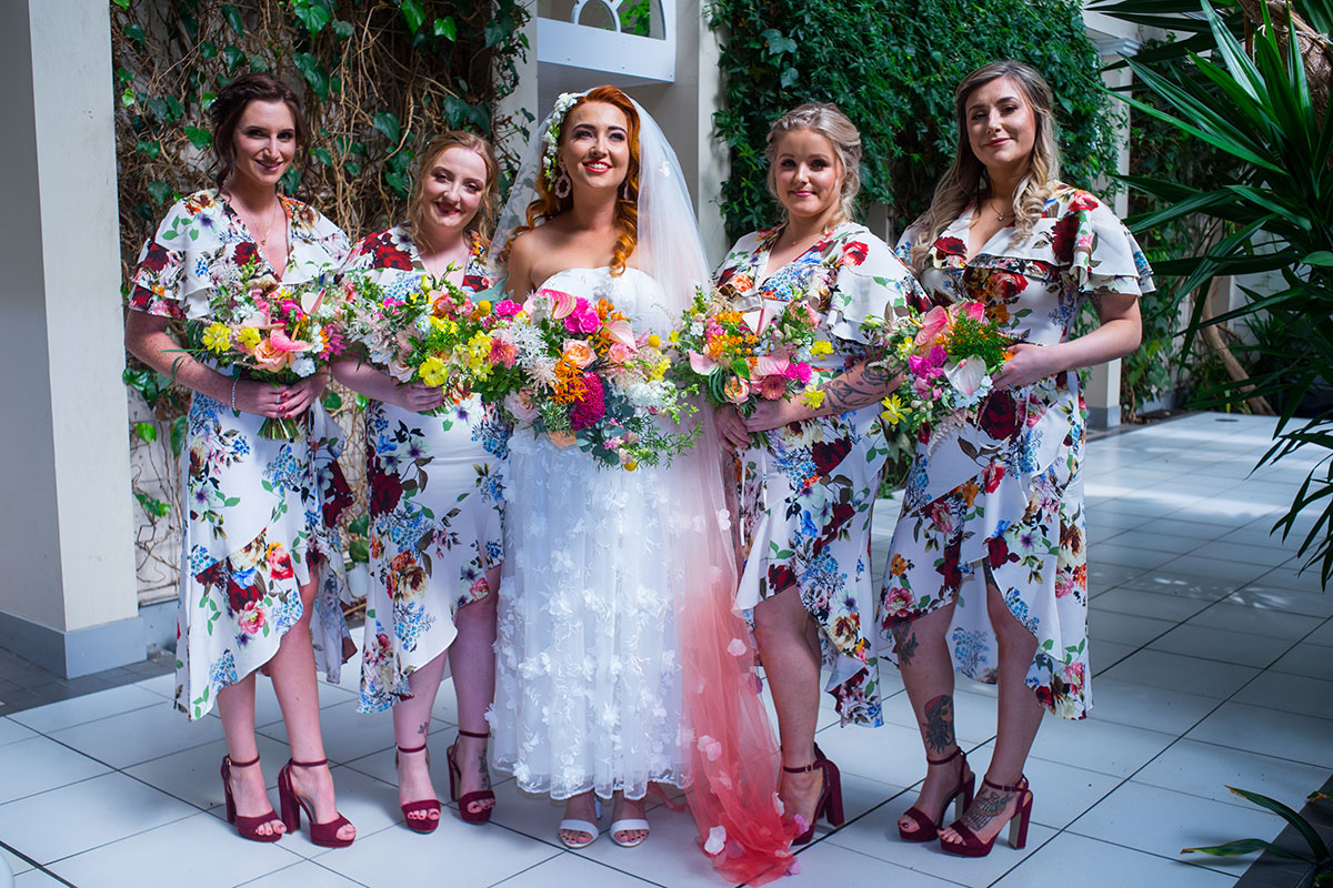 bride-and-bridesmaids-wearing-floral-dresses