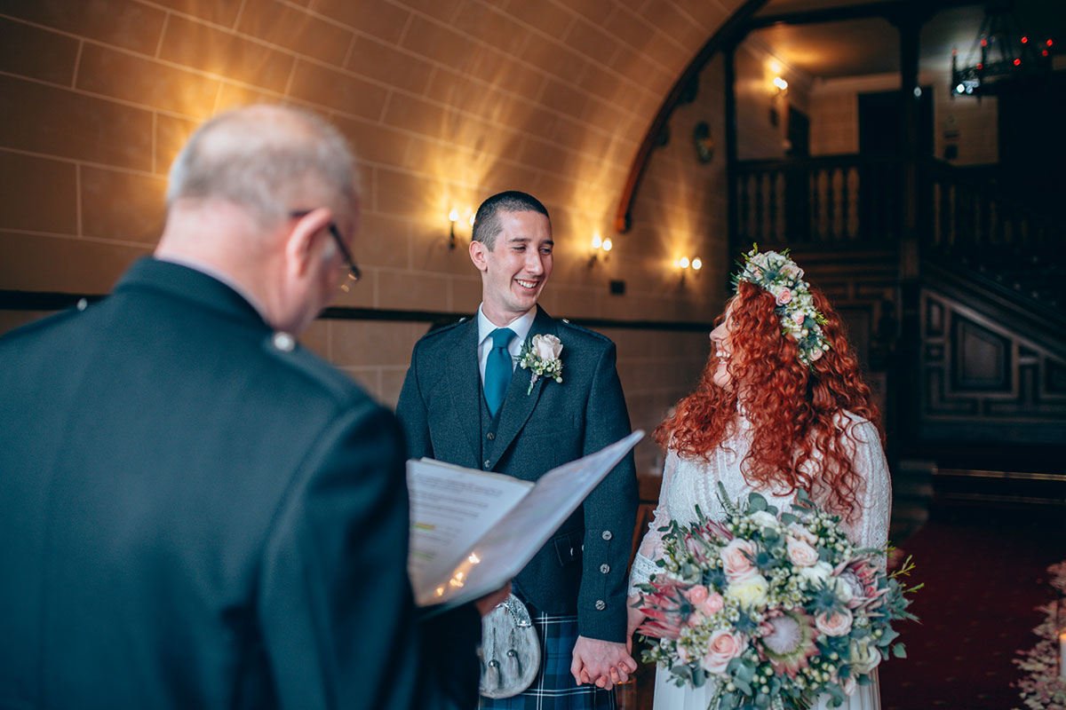 bride-and-groom-meeting-each-other-at-end-of-the-aisle