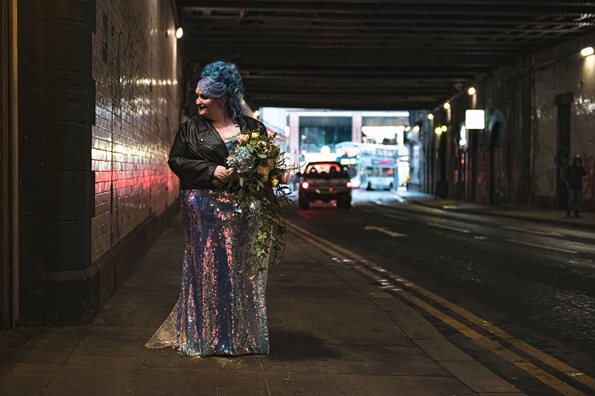 bride-with-blue-hair-in-painted-leather-jacket-and-sequin-dress