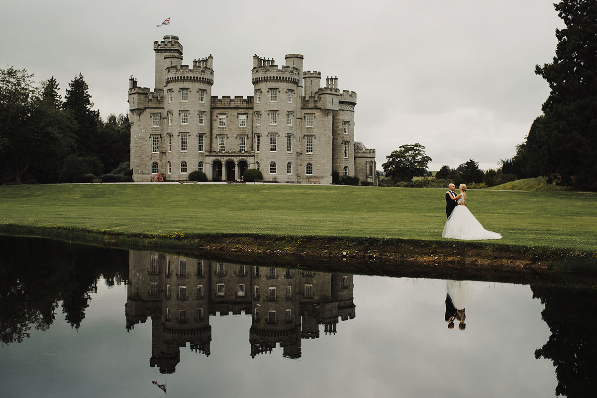 cluny-castle-with-bride-and-groom-in-front-of-it