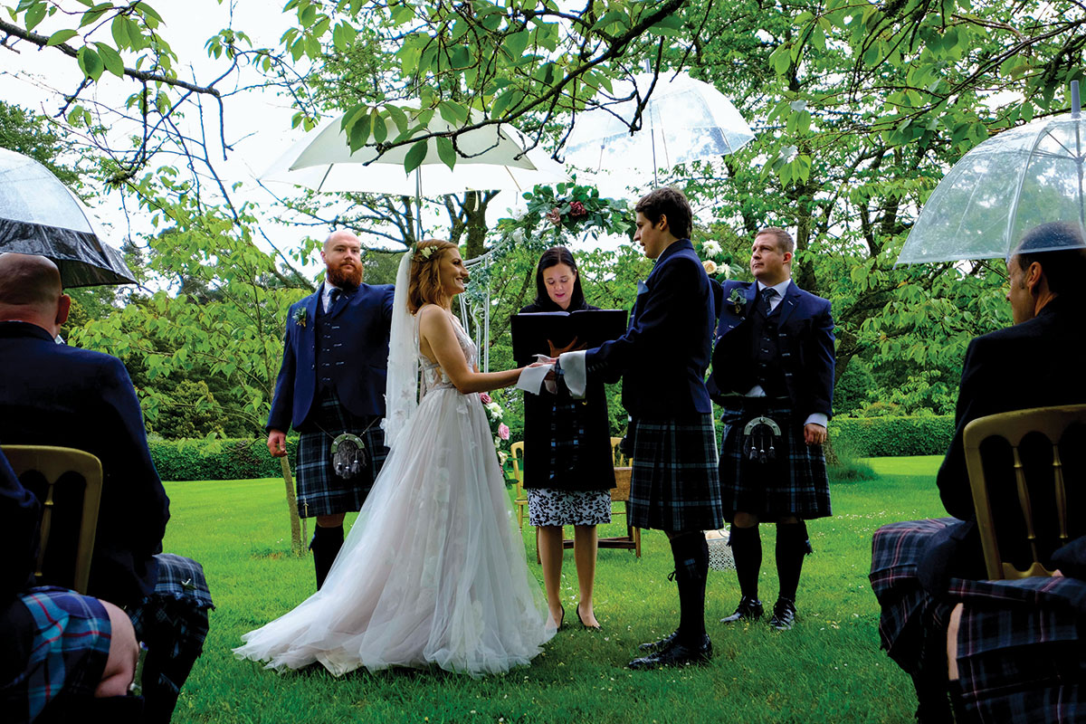 Ashley-Liv-Jamieson-couple-marrying-in-the-rain