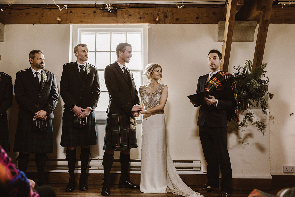 Eilidh-Sutherland-photography-couple-getting-married-in-kilt-and-sparkly-wedding-dress