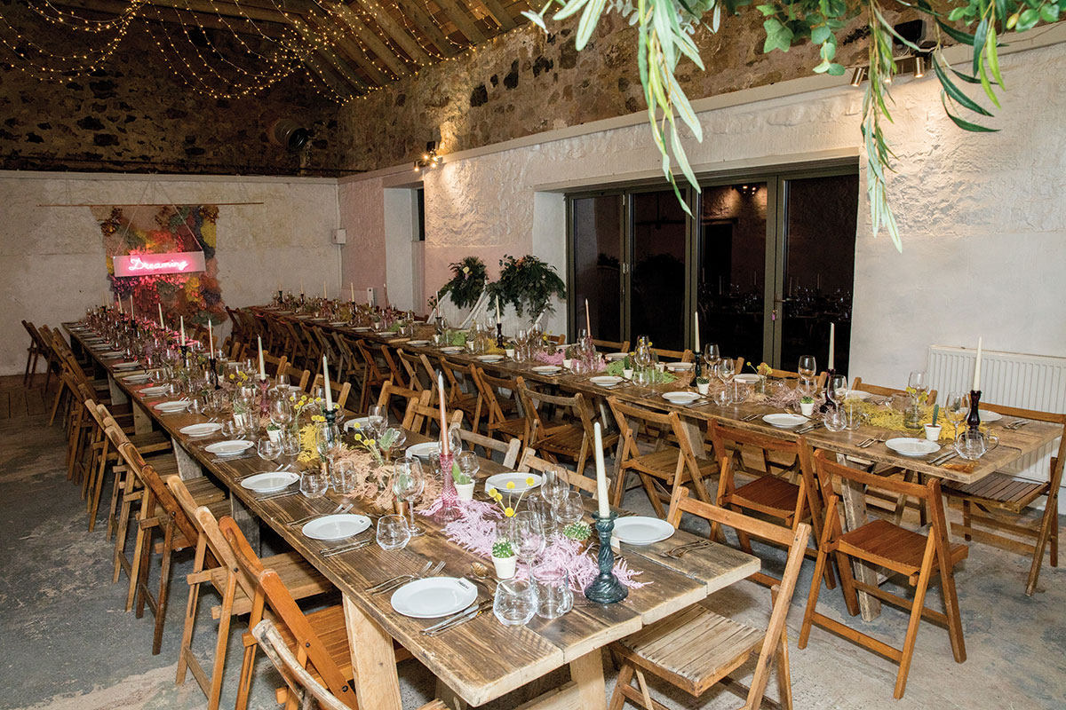 wooden dining tables in a barn