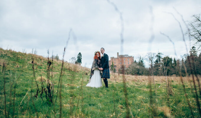 couple-in-front-of-dalhousie-castle