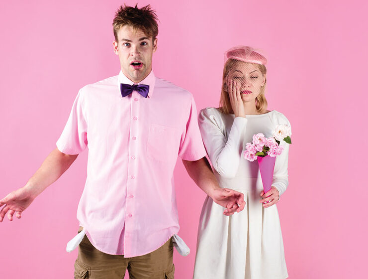 two people on a pink background