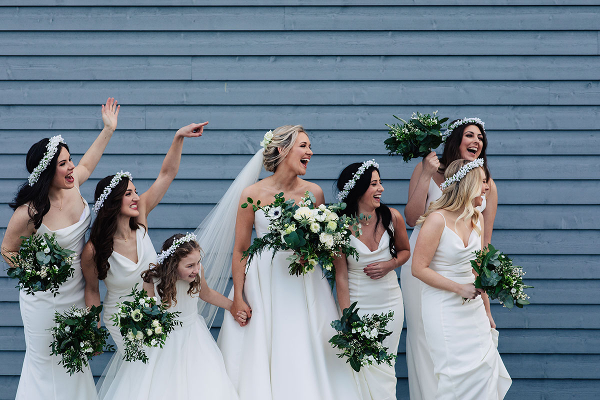 bride-bridesmaids-outside-barn