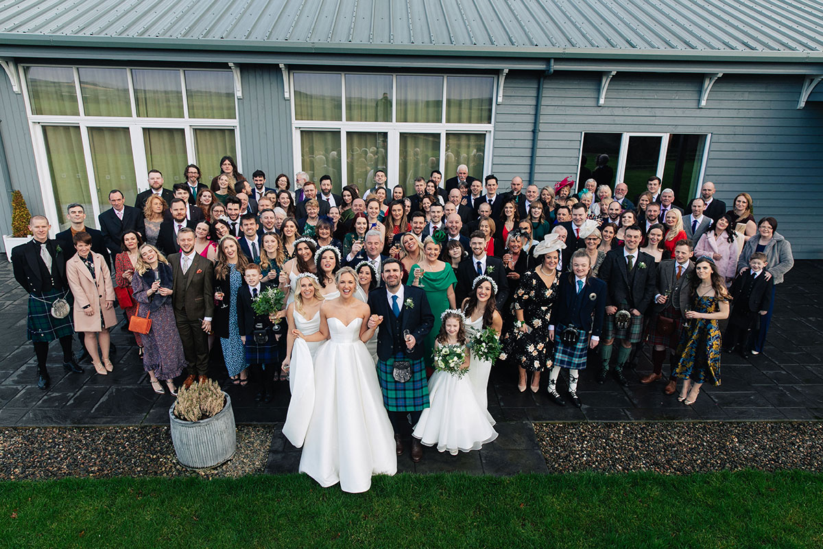 wedding-group-photo-barn-at-barra-castle